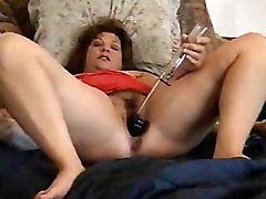 Pervert mature bitch has fun with her toys. Amateur