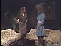 Blonde 80s porn queen takes a strap-on from her hot girlfriend