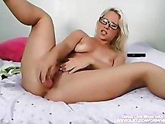 Hot blonde Kimmy with glasses masturbates tight pussy