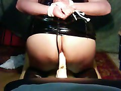 me tied up wearing a pvc dress riding a dildo