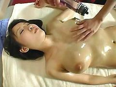 Oiled Japanese Babe Gets A Great Massage And Some Pussy Play