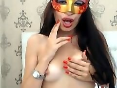 masked brunette smoking