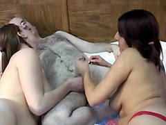 two girls pleasure a ugly fat guy