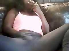 black girl smoking and playing