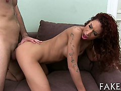 curly redhead babe gets fucked in the ass by fake agent