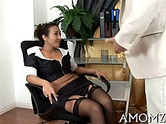 mature chick in stockings sucking down dick on her knees