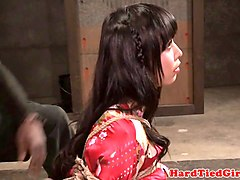 roped subdued asian babe caned and toyed