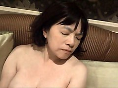 horny japanese milf kui somya toying on the sofa