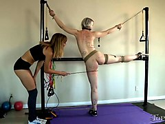 slender pale skin blonde babe bound and stretched for whipping