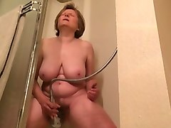 mature slut with big boobs masturbating in the bathroom