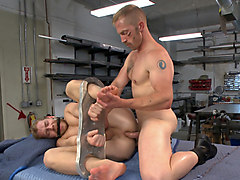 Cocky businessman bound and fucked in the metal shop
