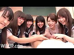 group of japanese schoolgirls sharing a cock