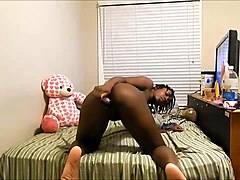 ebony girl with long legs masturbating passionately