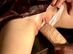 Oiled college girl in bondage learns to love giant cock