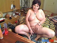 this nasty 52 yo mature lady with big tits is masturbating like mad