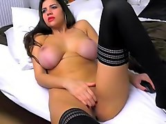 Hot busty brunette babe teasing with her big boobs and fingering her creamy pussy while on webcam