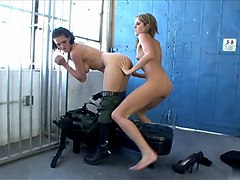 kinky security guard gets her strap on licked by prisoner babe
