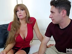 a kinky horny mature mom gives a head to that tremendous cock of a young stud