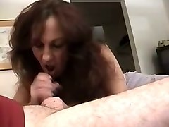 redhead mature woman with big breasts jerks off and sucks cock