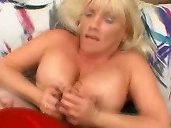 busty amateur cougar lady jerks off dick and performs titjob