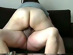 mature bbw wife fucks me in a cowgirl position on a couch
