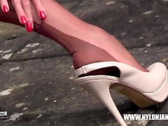 hot jane walking and teasing in sexy pair of nylon stockings