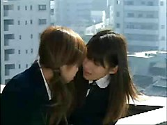 Two Beautiful Asian Girls Kiss